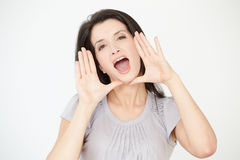Pracowniany portret Krzyczy W kierunku kamery kobieta Obraz Royalty Free