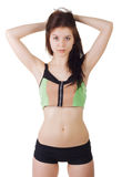Pracowniany portret młoda piękna sporty kobieta jest ubranym sporta wierzchołek i skróty Fotografia Stock