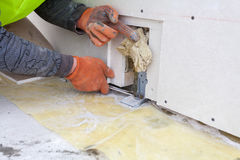 Pracowników budowlanych kahatów ściany góra z wyrwaniem Obraz Stock