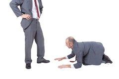 Pracownik błaga jego szef zdjęcie stock