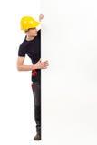 Pracownik budowlany czyta dużego sztandar Obrazy Royalty Free