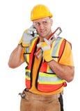 Pracownik budowlany na telefonie komórkowym odizolowywającym na bielu Zdjęcie Royalty Free