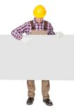 Pracownik budowlany przedstawia pustego sztandar zdjęcie stock