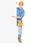 Pracownik budowlany target1018_0_ za panelem Obraz Royalty Free