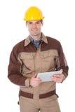 Pracownik budowlany trzyma cyfrową pastylkę Zdjęcia Royalty Free