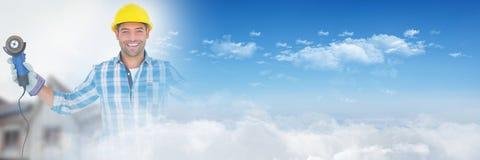 Pracownik Budowlany z świderem przed budową z niebo przemiany skutkiem Obraz Stock