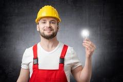 Pracownik budowlany z żarówką obrazy royalty free