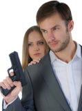 Pracownik ochrony z pistoletem i kobietą obraz stock