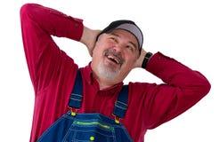 Pracownik, rolnik lub ogrodniczka w kombinezonu przyglądający up, obrazy royalty free