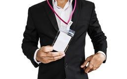 Pracownik w czarnym kostiumu pokazuje ID kartę, odosobnioną na białym tle Obraz Royalty Free