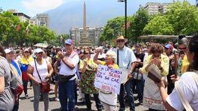 Pracownik?w ??dania dla wysokich pensji i rezygnacja Nicolas Maduro na mi?dzynarodowym dniu roboczym w Caracas, Wenezuela zbiory