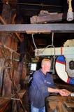 Pracownik wśrodku wiatraczka Fotografia Royalty Free
