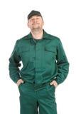 Pracownik w zielonym workwear. Obrazy Royalty Free