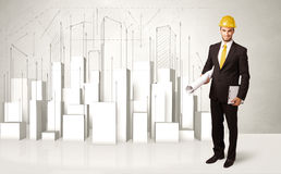 Pracownika budowlanego heblowanie z 3d budynkami w tle Zdjęcie Stock