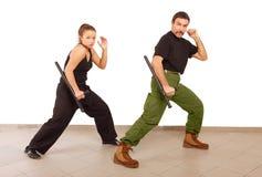 Practce del hombre y de la mujer con la matraca Imagen de archivo libre de regalías