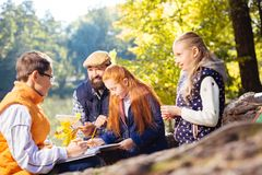 Positive nice smart children exploring forest together royalty free stock photography