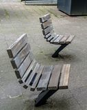 Practical and comfortable street furniture in Rotterdam, Netherlands. All these chairs can rotate on their axis and could be turned to any direction stock photography