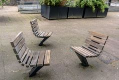 Practical and comfortable street furniture in Rotterdam, Netherlands. All these chairs can rotate on their axis and could be turned to any direction royalty free stock image