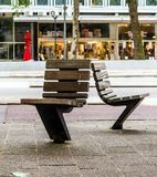 Practical and comfortable street furniture in Rotterdam, Netherlands. All these chairs can rotate on their axis and could be turned to any direction stock photos