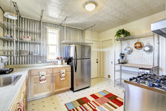 Practical design of kichen room with steel racks. Steel appliances and light tone storage cabinets stock image