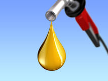Practical Gold. Gas pump with a drop of gas in the form of gold coming out.  Illustrates high gasoline prices Stock Photos