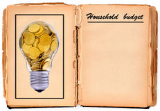 Practical guide. Old damaged hand book with household budget Royalty Free Stock Photo