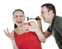 Practical joke. Surprised women being shocked by men with horn Stock Photos