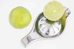 Lemon squeezer on white background. Practical object to squeeze lemon royalty free stock photos