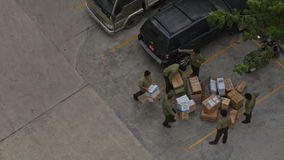 Practical Training of Fire Brigade Men Carry Boxes to Parking. NHA TRANG, KHANH HOA/VIETNAM - MAY 28 2016: Upper view practical training of fire brigade men stock video footage
