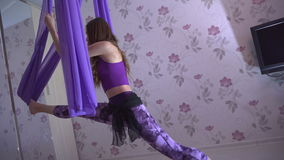 Practice of anti gravity fly yoga with hammock. stock video