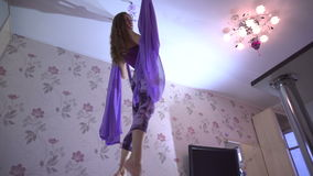 Practice of anti gravity fly yoga with hammock. stock footage