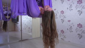 Practice of anti gravity fly yoga with hammock. stock video footage