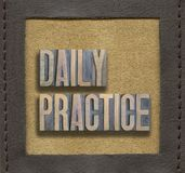 Daily practice framed. Daily practice assembled from vintage wooden letterpress inside stitched leather frame Royalty Free Stock Photos
