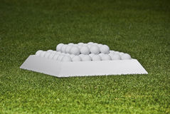 Practice Balls in a Pyramid Setting. Golf player's practice balls, set up before the start of play Stock Image