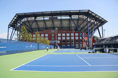 Practice courts and newly Improved Arthur Ashe Stadium at the Billie Jean King National Tennis Center. NEW YORK - AUGUST 25, 2015: Practice courts and newly royalty free stock photos