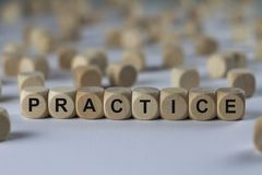 Practice - cube with letters, sign with wooden cubes Royalty Free Stock Photo