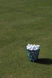 Practice Golf Balls. A bucket of practice range golf balls Royalty Free Stock Image