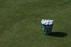 Practice Golf Balls. A bucket of practice range golf balls Stock Images