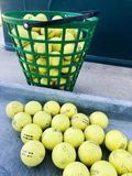 Practice Golf Balls. Large bucket of practice range golf balls waiting to be hit Royalty Free Stock Photography