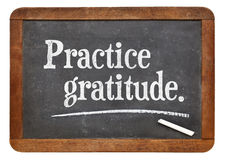 Practice gratitude on blackboard Stock Photo