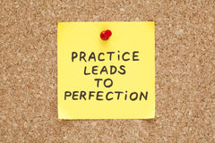 Practice Leads To Perfection. Written on an yellow sticky note on a cork bulletin board Stock Photo