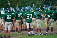 Practice lineup. Teenagers on a football team wait for their turn on the field Stock Images