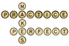 Practice makes perfect croosword. In old round typewriter keys isolated on white Royalty Free Stock Photos