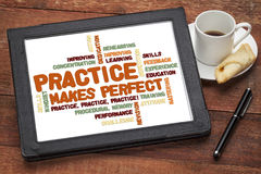 Practice makes perfect. Related word cloud on a digital tablet with a cup of coffee Stock Photos