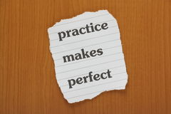 Practice Makes Perfect. Reminder note on a wooden background Royalty Free Stock Photography