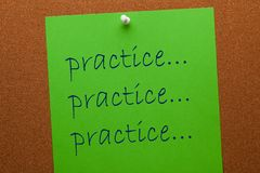 Practice Message On Cork Board. Practice word on green paper sheet pinned on cork board. Business concept stock images