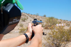 Practice Shooting a Handgun. A closeup of a teenager learning how to shoot a handgun Royalty Free Stock Photography