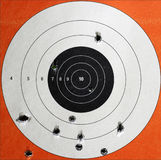 Practice Target with Bullet Holes. A Closeup of a practice target used for shooting with bullet holes in it Stock Images