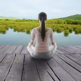 Girl meditation in wood Floor. stock image