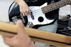 Practice your music to prepare for the show. Playing bass guitar. Music is beneficial to mind, concentration, imagination and creativity stock photo